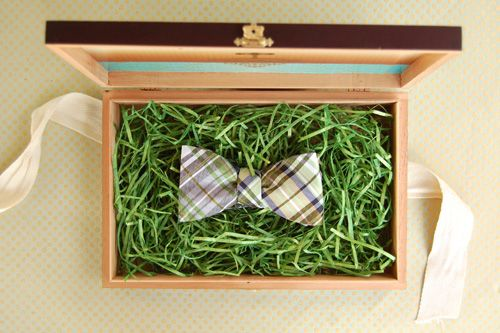 packaging idea: fake grass in a box with present on it.