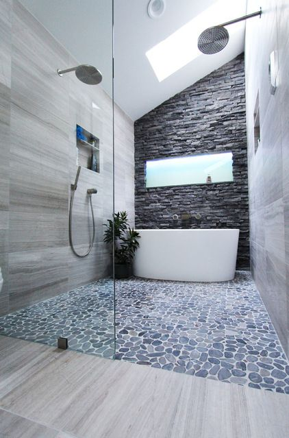 wow... slate bathtub wall + pebbled floor