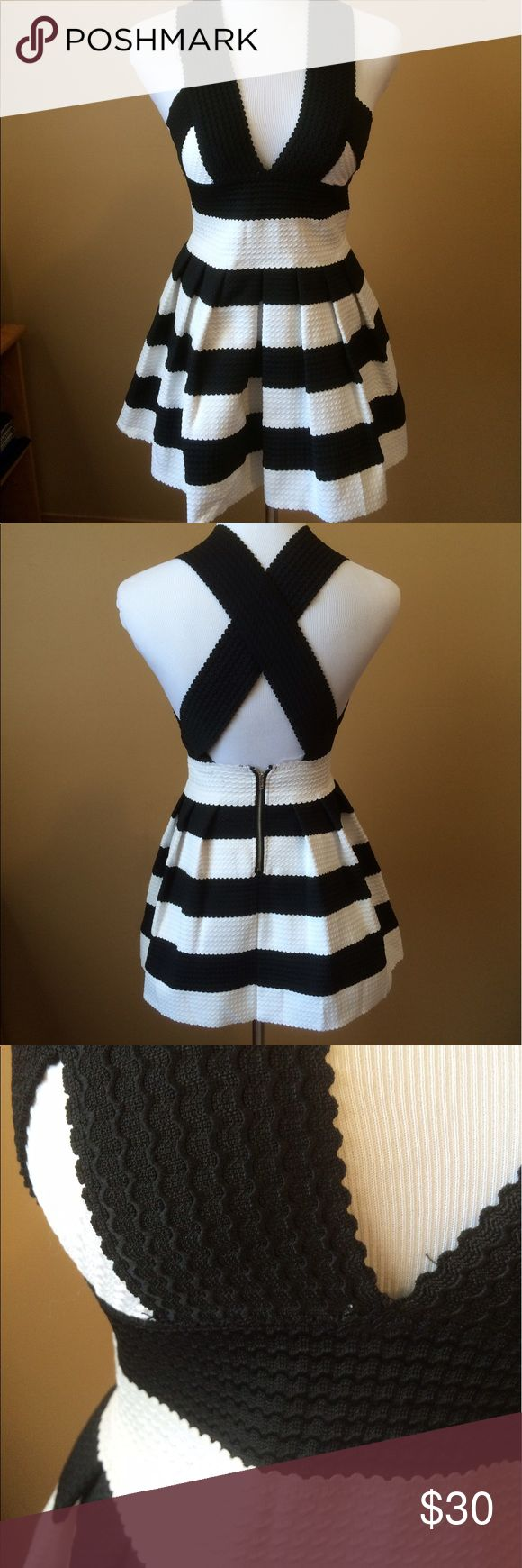 Black and white striped structured dress Black and white stripe mini dress!! Structured with a cross back. Great dress to go clubbing! Dresses Mini