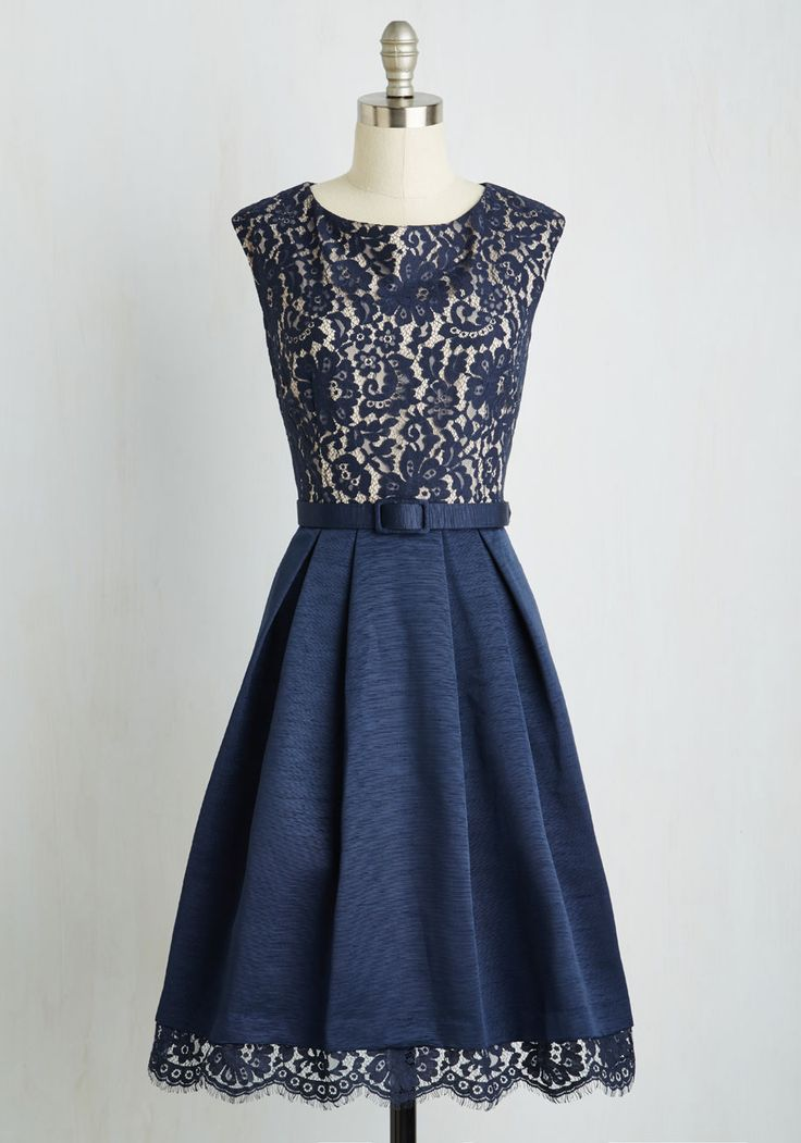 Strolling through antiquarian avenues, the most exquisite sight to behold is how lovely you look adorned in this midnight blue dress. This belted beauty flaunts a floral lace bodice and textured, pleated skirt with delicate lace details at the hem. Ooh la la!