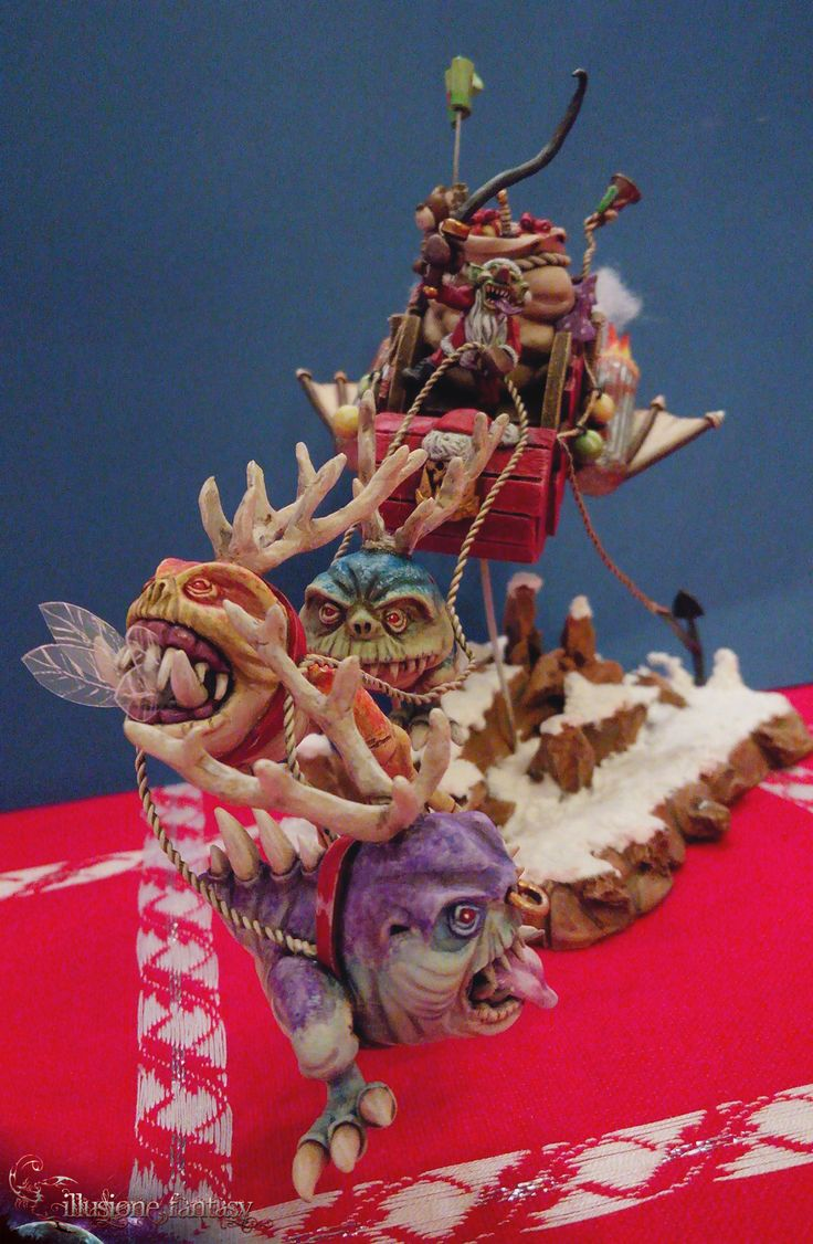 """Una simpatica slitta guidata da un Goblin che ha rubato vestiti e regali a Babbo Natale, trainata dalle sue iper-imbalzanti """"Squiggarenne""""!!"""