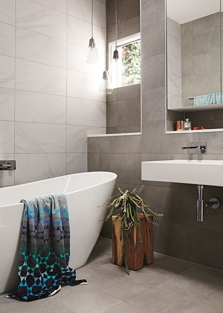 Swathed in moody charcoal hues, this bathroom is the perfect pamper zone. A sumptuous freestanding bath beckons after a long day.