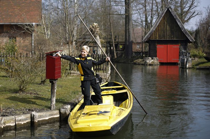 Andrea Bunar delivers the mail by boat in the village of Luebbenau, about 100 kilometers (62 miles) south of Berlin, Germany, on March 25, 2015. For 118 years the German mail service Deutsche Post has delivered the mail between March and October with a boat in that area. The Spreewald landscape is irrigated with more than 200 small canals, and is an official UNESCO biosphere reserve.