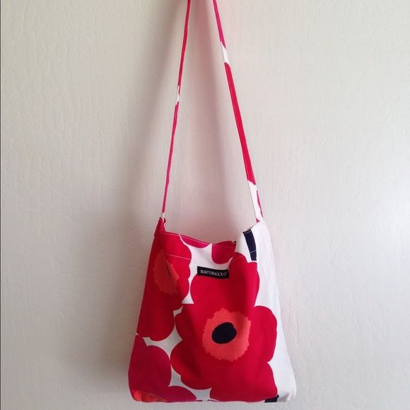 Marimekko Long  Strap Shoulder Tote Bag Red Daisy Super cute tote that has never been used has long strap so bag can be draped over shoulder has snap closure on top as well as an inside zip pocket strap is long enough for bag to be worn cross body in good condition- looks unused has s tiny spot on back Marimekko Bags Totes
