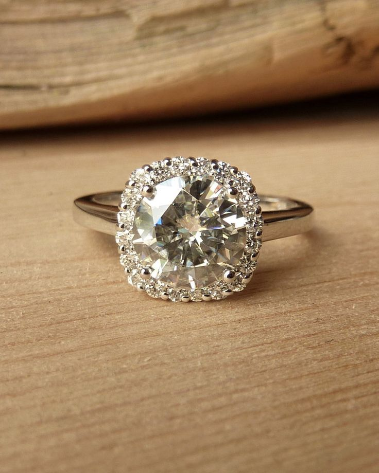 So pretty!! Could definitely get this with my next paycheck! :) Round  Moissanite with Cushion Halo Ring. $2,795.00, via Etsy.