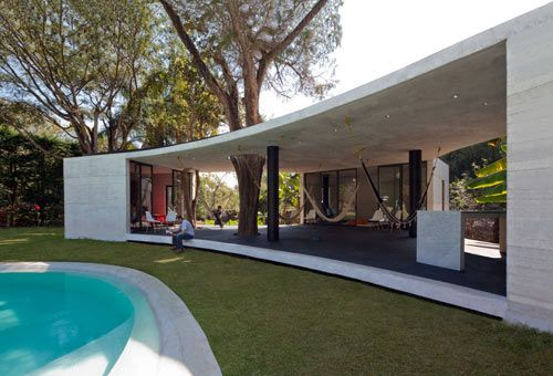 Designed by Cadaval & Solà-Morales as the first of many bungalows in Tepoztlan, Mexico, the Tepoztlan Lounge is most impressive and where we'd like to call home. Located south of Mexico City in a place that's known for attracting the creative types, the curvy, triangular-shaped guesthouse will be part of a larger series in which the spaces can be rented for years, months, or even days.