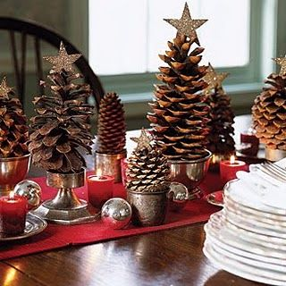 Christmas table decor. Liking those little pine cone trees and stands.