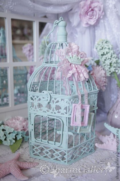 Sure love the color of this bird cage.
