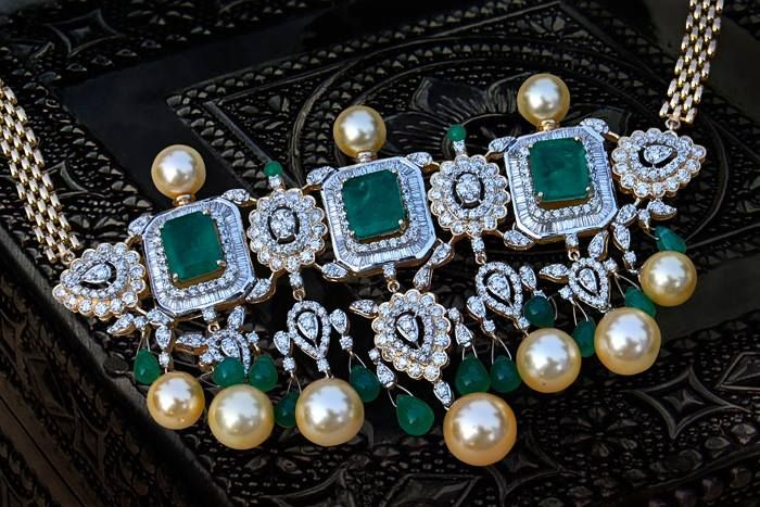Tanmani pendant with a modern twist, with emerald and diamond. Tanmani is traditional pearl choker in Maharashtra