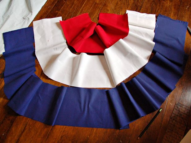 DIY Patriotic Bunting tutorial. To make four swags, purchase 1/2 yd red twill, 1 1/8 yd white twill, 2 yd blue twill. Use ribbon to attach to porch and omit grommets.