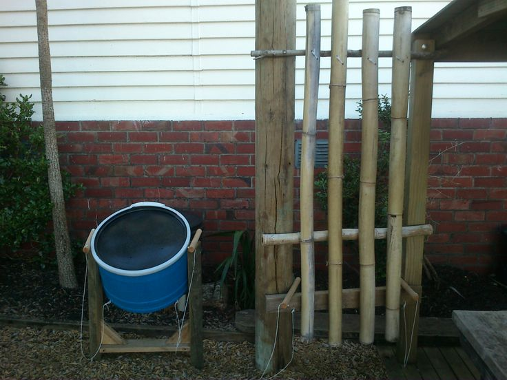 """Drum your hearts out kids! A bamboo drum with a half plastic """"drum"""" Great for outdoor music."""