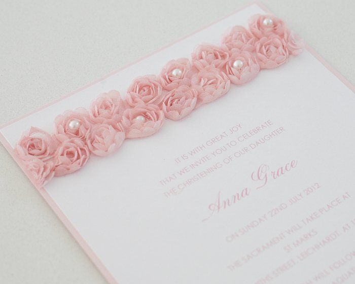 Beautiful Christening Invitation with pink rose and pearl detail.