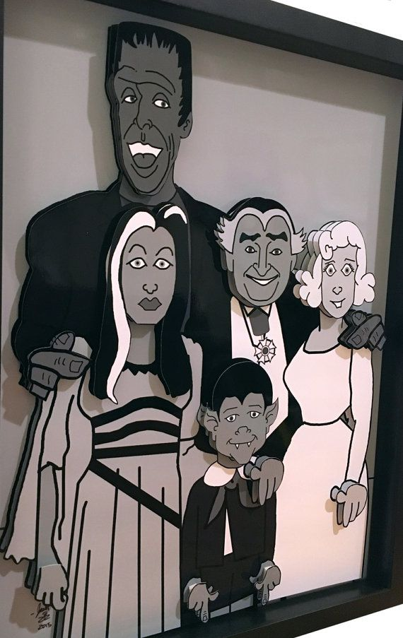 The Munsters 3D pop art features Herman Munster, Lily Munster, Grandpa, Marilyn Munster and Eddie Munster. The papercut artwork features the entire Munsters family in 2D, while each of their faces and hands are rendered in 3D. The artwork includes a beautiful black shadow box frame. This