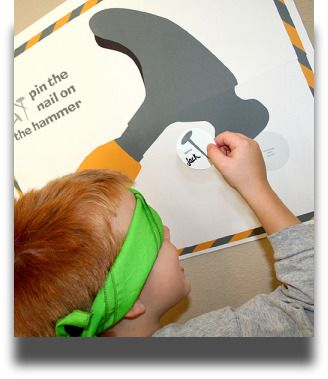 Pin the nail on the hammer. For the construction themed birthday party.