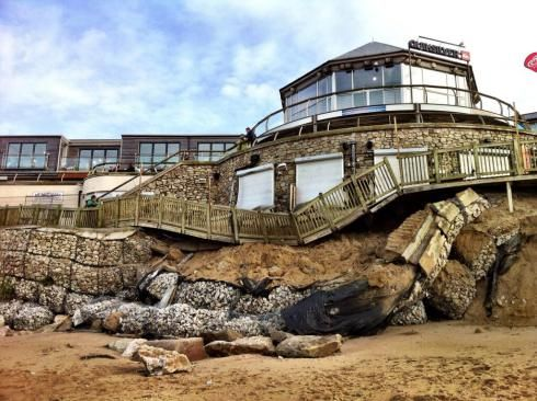 Fistral Beach Bar in Newquay, Cornwall, UK damaged in recent storm with more bad weather on the way. More info and pics at http://beachbarbums.com/2014/01/02/fistral-beach-bar-damage/