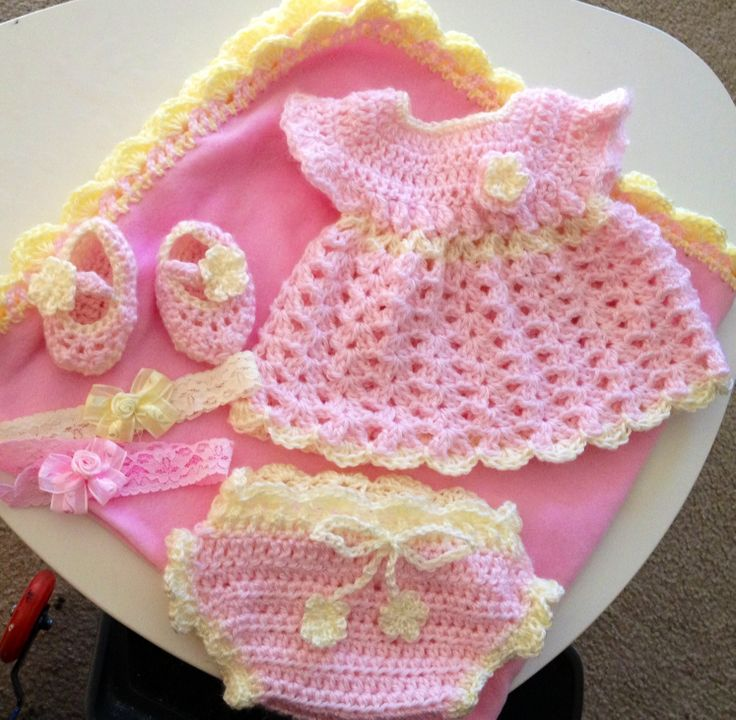 Crochet baby girl dress, panty, Mary Jane shoes and shell edge on Fleece blanket. This was a lot of fun to make and gr8 gift to give. I made up my own pattern for blanket and used www.oocities.com/crotiques under baby clothes. Not sure if they are still updating the site but was glad to have the free pattern.