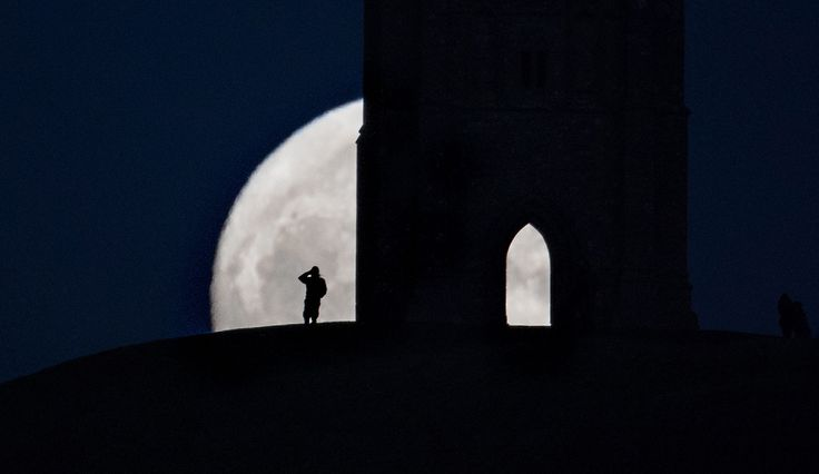 A so-called wolf moon rises over Glastonbury Tor on January 11, 2017 in Somerset, England. In some parts of the world, the January full moon is nicknamed the wolf moon, which dates back to the days when native American tribes gave names to each month's full moon to help keep track of the seasons.
