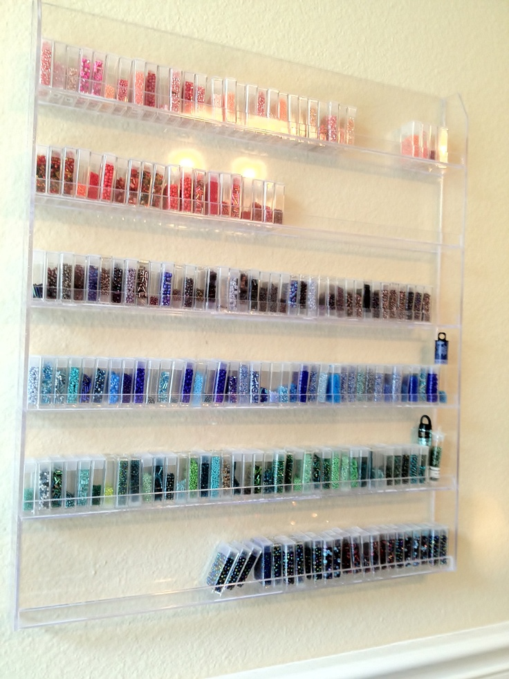 Craftroom Seed Bead Storage Idea: I used nail polish rack and flip-top storage containers (you can find these online) to organize all my seed beeds.