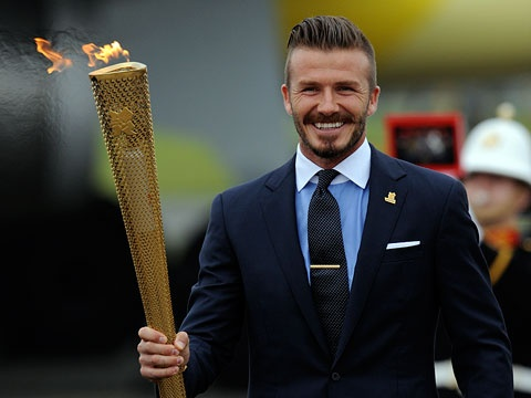 David Beckham with the Olympic Torch