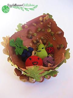 Crochet autumn fruits in the handmade bowl.
