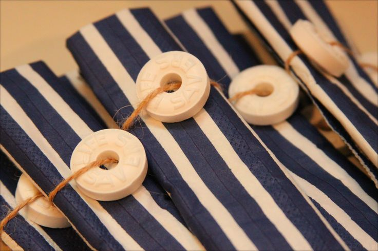 A great idea for a Nautical table setting! Stripes Again - Available at Party City!