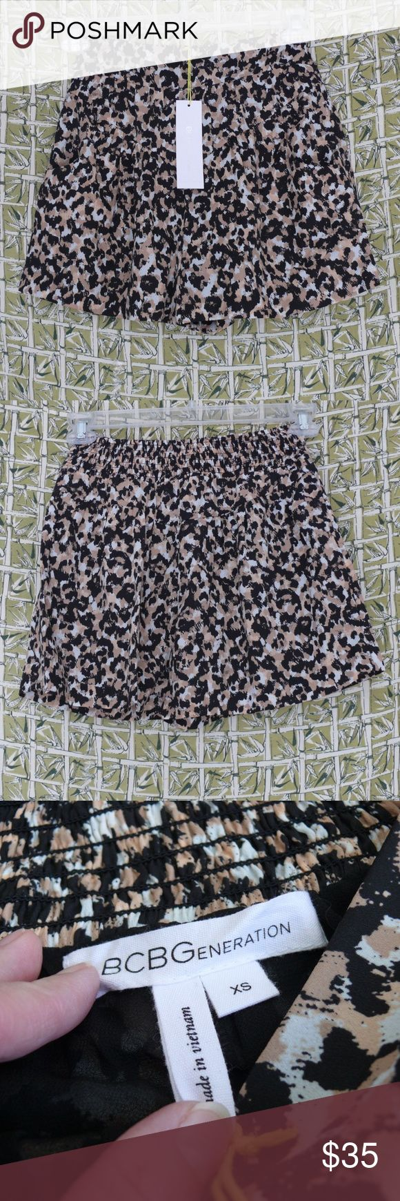 """BCBGeneration XS Shorts Animal Print Pockets Lined BCBGeneration   New With Tags  Women's Shorts   Animal Print   Side Pockets   Fully Lined   Elastic Back Panel   Dark Buff-Beige Multi   Tag Size XS  The following measurements are approx.  and taken with the shorts laid flat  Waist - 12 1/2"""" Overall Length - 14 1/2"""" BCBGeneration Shorts"""