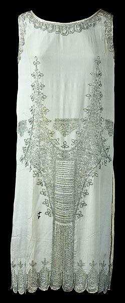 1920s  beaded dress- 1920-1925 because it doesn't have a defined dropped waistline, it's just a waistless, tubular shape.