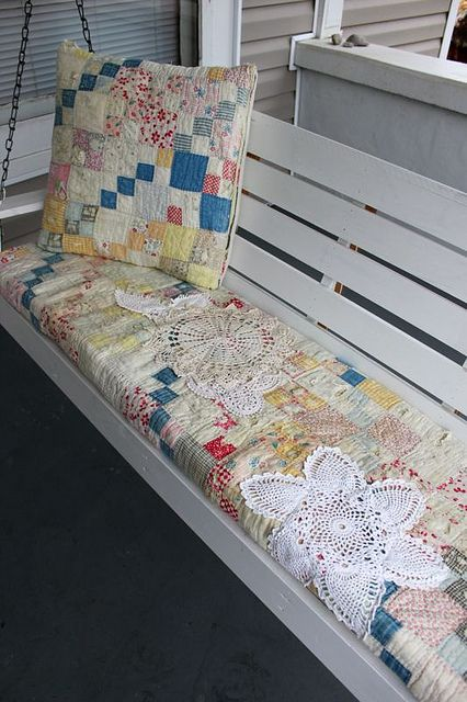 Great upcycle for those old quilts that are very worn or have holes in them. Make a porch swing quilt cushion! Beautiful idea!