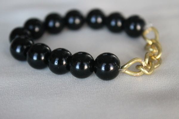 Black beaded bracelet with large golden chain