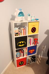 Bookcase with Super Hero bins in our superhero nursery!