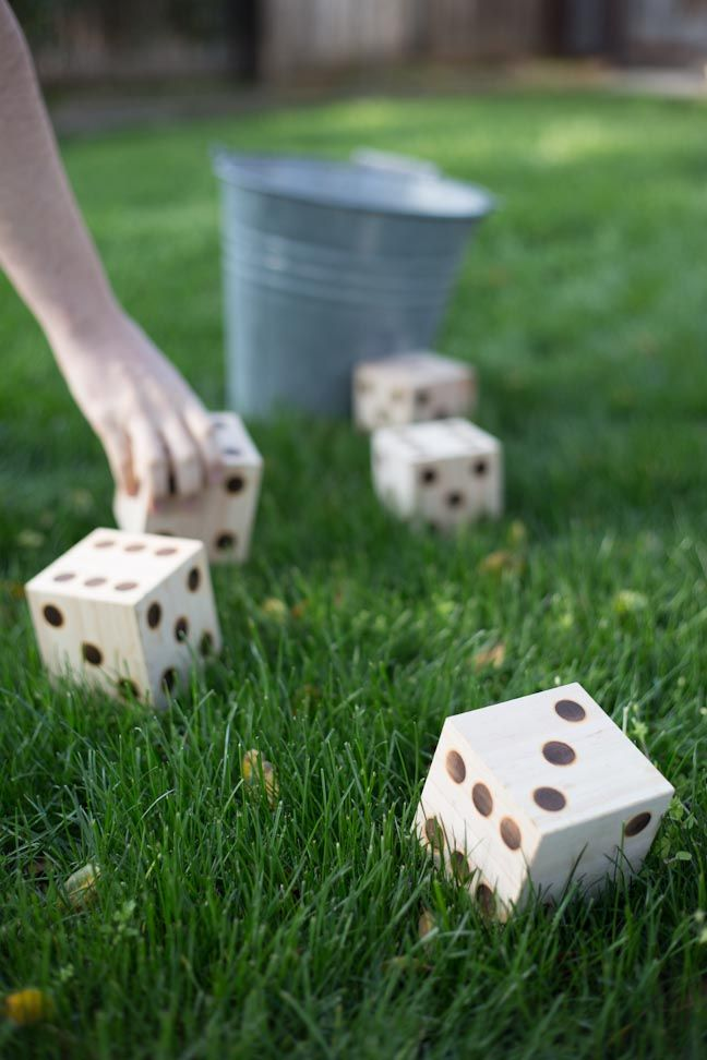 Here is an easy DIY to super-size one of your favorite board games to yard-game status. We are making a giant set of dice for a game of DIY Yard Yahtzee.