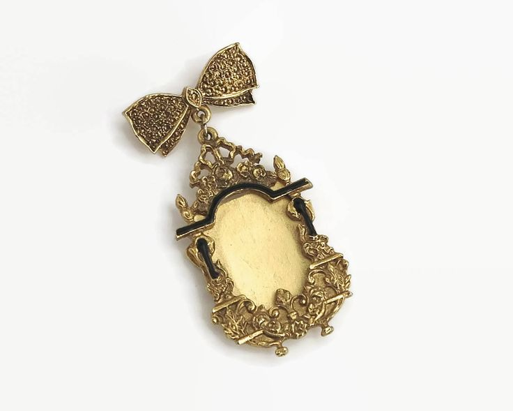 Large photo frame brooch, elaborate gold metal and black enamel frame hangs from gold metal bow, rollover clasp, Victorian revival, 1970s by CardCurios on Etsy