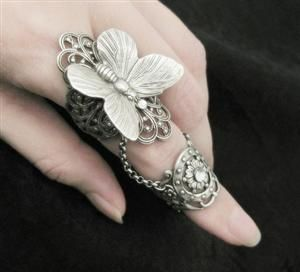 Ring | Tiffany Tinsley. 'Fairy's Touch'. Sterling silver plated brass filigree and crystal Swarovski treasures. The main and knuckle bands are connected with sterling silver plated steel chain.