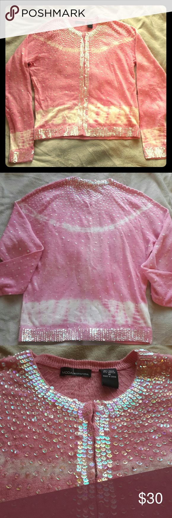 """Tie-Dyed Sequined Sweater Do you love to sparkle and shine? Then this is the cardigan for you! Size M, B ~38"""", W ~33"""", L ~22.5"""", sleeves ~25"""". Bought from Victoria' Secret catalog and never worn. The sequins look clear or iridescent depending on the light.  There is one on the top right shoulder that's loose. Easy fix (though you'd never miss it, as this sweater is LOADED w/sequins!). Hook & eye closures.  Don't like the price? Send me an offer! Moda International Sweaters Cardigans"""