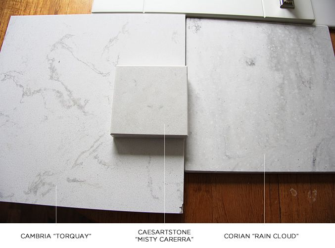 3 countertop alternatives to carrara marble Cambria in Torquay , Caesarstone in Misty Carrera , Corian Rain Cloud.