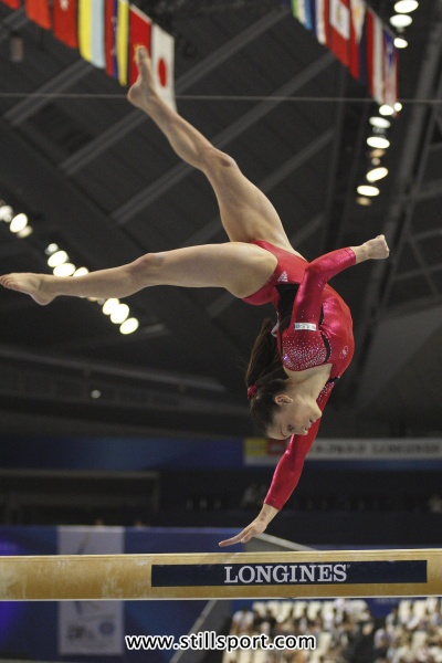 Jordyn Wieber, USA Women's Gymnastics, looking pretty fierce doing a one handed flip flop on the balance beam.