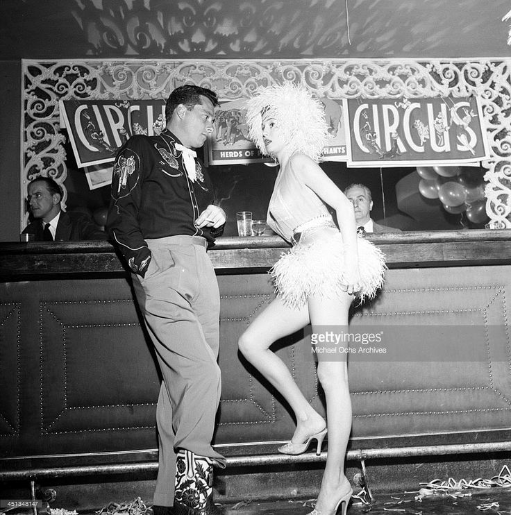 Conrad Hilton, Jr with guest attends Sonja Henie Circus party in Los Angeles, California.