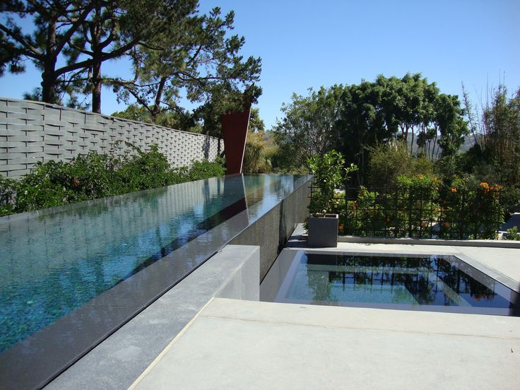 La Jolla, San Diego: Lapitec's Grigio Piombo in the Fossil finish was used as a surround for the villa's 25 metre pool. Lapitec's minimalistic design, large format slabs and slip resistance made it the ideal material for the project. #Lapitec