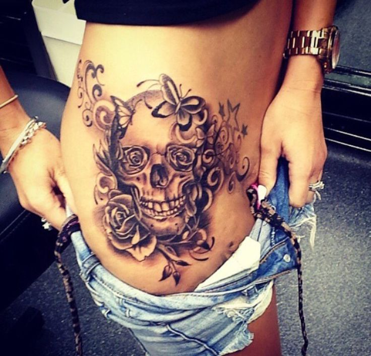Skull w/ Butterfly Tattoo on Hip