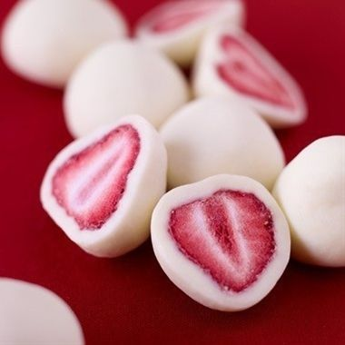 Dip strawberries in yogurt, freeze and you get this healthy snack!    ETA: I suggest grapes or sliced bananas instead of berries or flavoured yogurt (or even melted chocolate) instead of plain.  ETA2: Check out another, similar idea: http://pinterest.com/pin/224124518927527270/