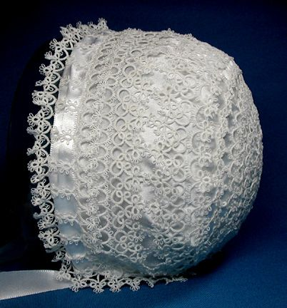 Baby bonnet tatted with white size 80 cotton tatting thread. The lightweight satin lining is hand-stitched. It was created without a pattern by combining designs of various tatted lace edgings