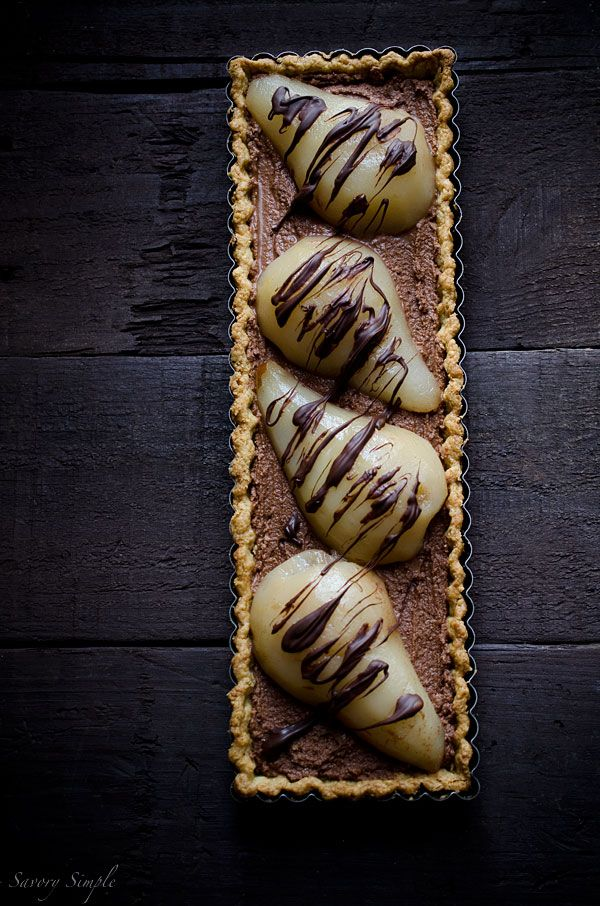 This decadent Chocolate Mousse Poached Pear Tart is the perfect ending to a romantic meal!