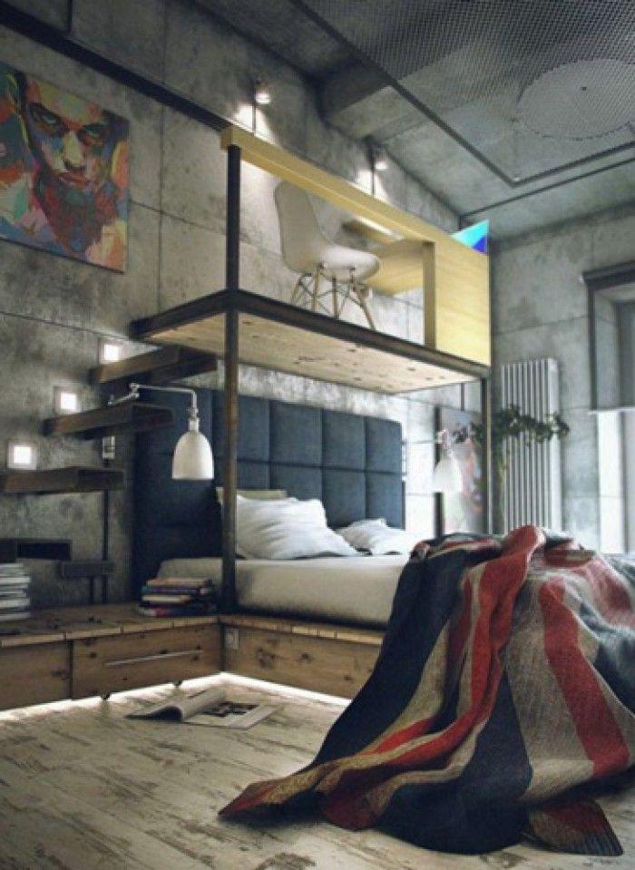 Stoere industriële slaapkamer: beton muren, bureau boven bed, 'Union Jack' dekbedovertrek of plaid.