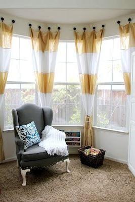 combine curtain idea with a white café curtain in bay window