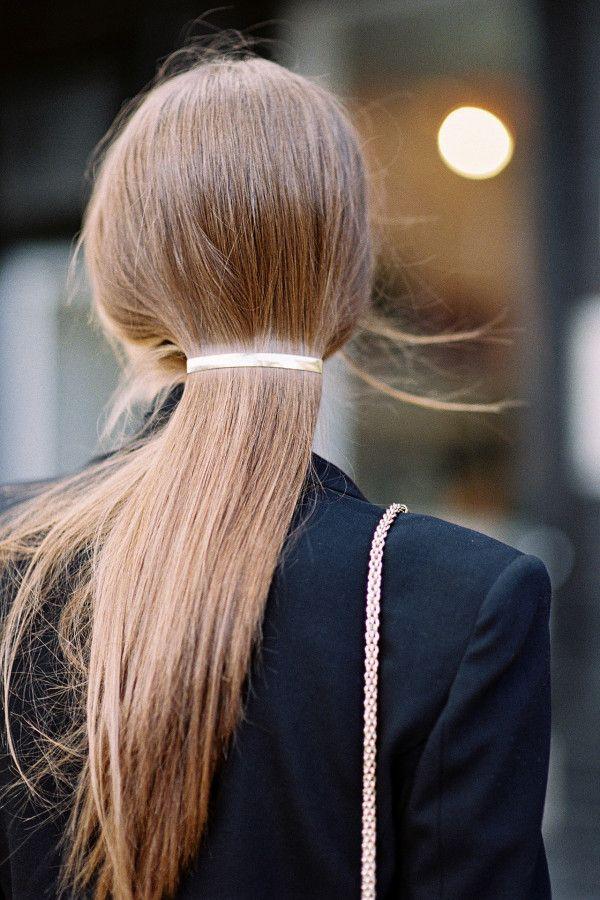 Gather sleek, straight locks into a single metal barrette—the effect is très chic.