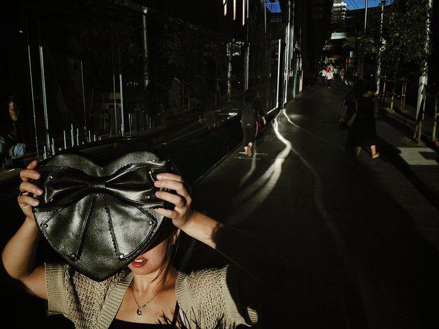 Oliver Lang - Hiding from the light, Market St, Sydney by oggsie, via Flickr