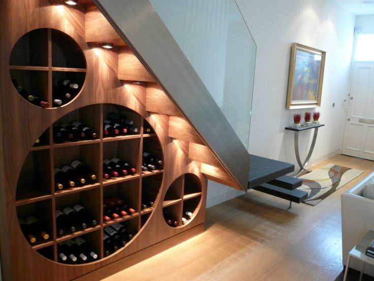 Wine cellar beneath contemporary staircase (De Space Alchemy Ltd)