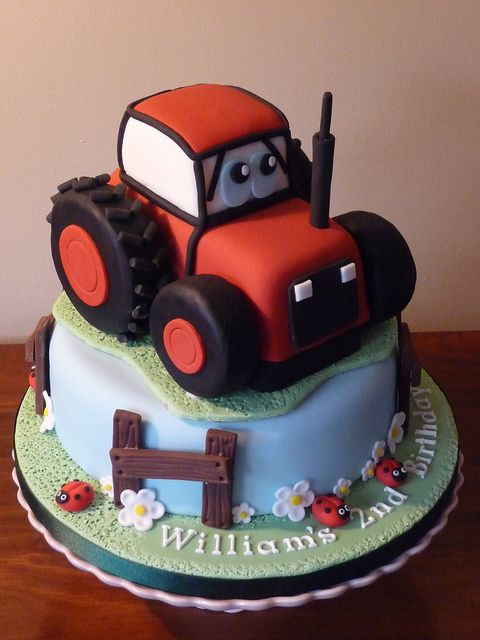 Red Tractor Cake. 10 inch round and sponge cake tractor with rice crispy treat wheels, ermagerd