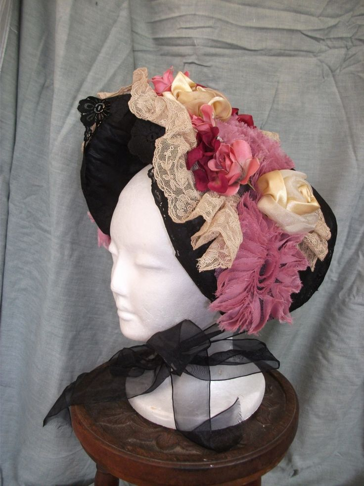 'Victorian' hat with flower and doilly trim.