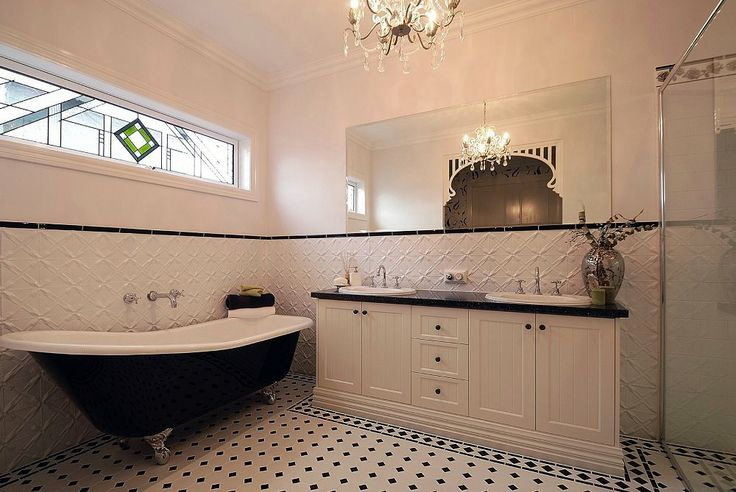 Just look at this bathroom.  Doesn't the pressed metal on the lower walls look divine.  The tiles complement the bathroom so well.  I just love the whole room. Photo courtesy of www.pressedtinpanels.com